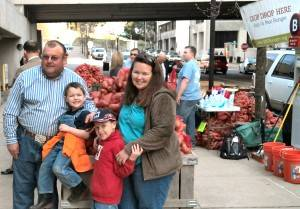 Mack Rogers, president of the National Sweet Potato Council, is joined by his wife, Jena, and sons, Elijah and Knox, after delivering 19,000 pounds of sweet potatoes during Ag Day on the Hill. ~ Photo by Linda Tozer, Society of St. Andrew