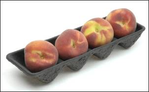 Perfect peaches in a pulp tray.