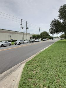 cars lined up to receive a box of food in Orlando, Florida